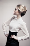 Beautiful Blonde Woman. Retro Fashion Image. Stock Photo