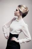 Beautiful Blonde Woman. Retro Fashion Image. Stock Photo