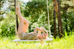 Beautiful blonde woman on the rope swing Stock Photography