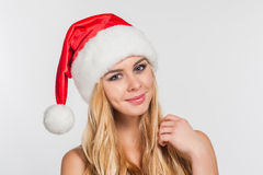 Beautiful blonde woman in Santa hat Stock Photos