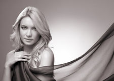 Beautiful blonde woman with shawl stock photography