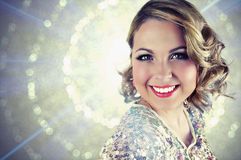Beautiful blonde woman with short curly hair and shining glittery background. Stock Photography