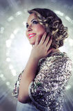 Beautiful blonde woman with short curly hair and shining glittery background. Stock Images