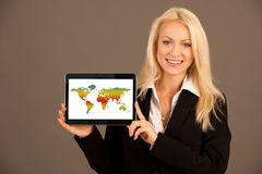 Beautiful blonde woman showing tablet with blank screen for addi. Tional text or graphic Royalty Free Stock Photo