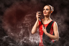 Beautiful blonde woman singer with a microphone Royalty Free Stock Photography