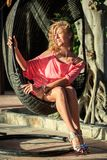 Beautiful Blonde Woman Sitting In The Park Royalty Free Stock Images