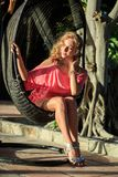 Beautiful Blonde Woman Sitting In The Park Stock Photos