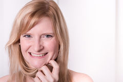 Beautiful blonde woman is smiling - Portrait  close up Royalty Free Stock Photo