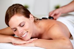 Beautiful blonde woman smiling at spa Stock Images