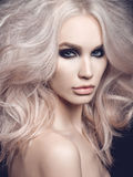 Beautiful blonde woman with smoky eyes makeup Stock Photo