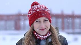 Beautiful blonde woman on a snowy winter day stock footage