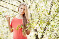 Beautiful blonde woman in spring stock photo