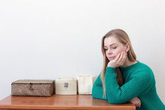Beautiful blonde woman standing near a chest of drawers Stock Photography