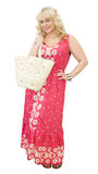 Beautiful blonde woman with straw bag Stock Photography