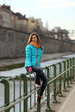 Beautiful blonde woman on the streets of Vienna. Young woman with blue jacket in a European city royalty free stock photo