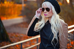 Beautiful blonde woman in sunglasses outdoors Royalty Free Stock Photo