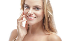 Beautiful blonde woman touching her healthy skin face Stock Image