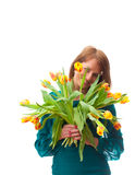 Beautiful  blonde woman with tulips bouquet Stock Photos