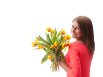 Beautiful  blonde woman with tulips bouquet Royalty Free Stock Image