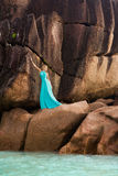 Beautiful blonde woman, turquoise blue long dress, rocks, outdoor Royalty Free Stock Photography