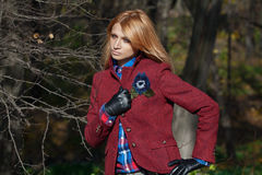 Beautiful blonde woman in tweed jacket and leather gloves in aut Stock Images