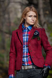 Beautiful blonde woman in tweed jacket and leather gloves in aut Stock Photography