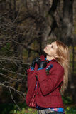 Beautiful blonde woman in tweed jacket and leather gloves in aut. Pretty woman with flowing hair in tweed jacket and leather gloves walking and posing in autumn Royalty Free Stock Photos