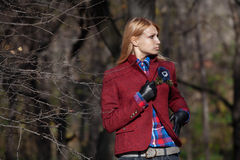 Beautiful blonde woman in tweed jacket and leather gloves in aut. Pretty woman with flowing hair in tweed jacket and leather gloves walking and posing in autumn Stock Photo