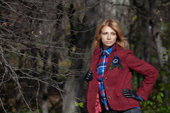 Beautiful blonde woman in tweed jacket and leather gloves in aut Royalty Free Stock Photography