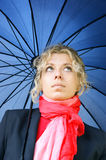 Beautiful blonde woman with umbrella Stock Images