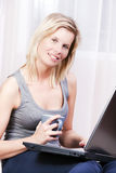 Beautiful blonde woman using a computer. Royalty Free Stock Image