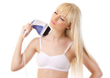 Beautiful blonde woman using massager Stock Images