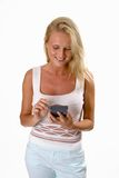 Beautiful blonde woman using a PDA. Isolated on white royalty free stock photos