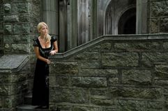 Beautiful blonde woman in vintage black dress Royalty Free Stock Image