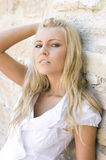 Beautiful blonde woman by vintage wall Royalty Free Stock Photography