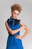 Beautiful blonde woman wearing blue dress. Royalty Free Stock Photos