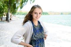 Beautiful blonde woman wearing elegant dress posing standing on beach Royalty Free Stock Images