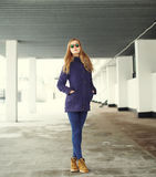 Beautiful blonde woman wearing a jacket and sunglasses Royalty Free Stock Photography