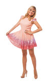 Beautiful blonde woman wearing pink dress and shoes Royalty Free Stock Photo