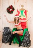 Beautiful blonde woman wearing santa claus clothes Stock Image