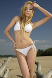 Beautiful blonde woman in white bikini Royalty Free Stock Image