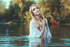 Beautiful blonde woman in white. royalty free stock photos