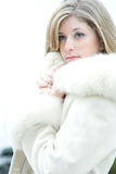 Beautiful blonde woman in white fur coat Royalty Free Stock Images