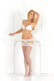 Beautiful blonde woman in in white lingerie Royalty Free Stock Image