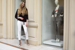 Beautiful blonde woman in white pants and corduroy jacket Stock Photo