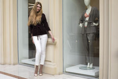 Beautiful blonde woman in white pants and corduroy jacket Stock Photos