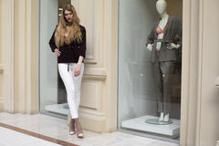 Beautiful blonde woman in white pants and corduroy jacket Royalty Free Stock Images