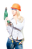 Beautiful blonde woman worker wearing a white shirt and jeans with helmet drill glasses & looking at camera white background Royalty Free Stock Photos
