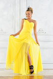 Beautiful blonde woman in a yellow dress. Stock Images