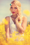 Beautiful blonde woman in yellow field Royalty Free Stock Photography